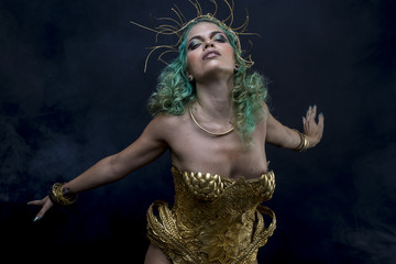 Priestess Latin woman with green hair and gold costume with handmade flourishes, fantasy image and tale