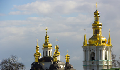 Domes of Kiev Pechersk Lavra against the background of a cloudy sky