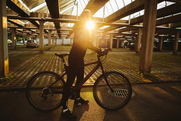 bicycle style man with sunlight. Cycling outdoors at sunset