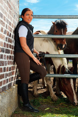 Young Woman On Horse Ranch