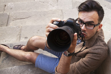 A photographer takes pictures (Creativity, hobbies, work, freelance concept)