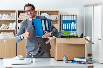 Man moving office with box and his belongings
