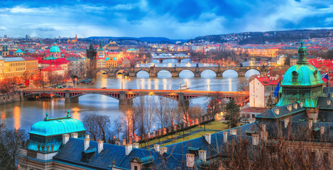 Wall Murals Prague Prague at Twilight, view of Bridges on Vltava. Panorama view at Vltava river delta in Prague with famous view on bridges vista. Twilight scenery. Czech Republic.
