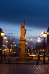 Wall Mural - Sculpture of Saint Roland and stone bridge over Daugava river in old city Riga