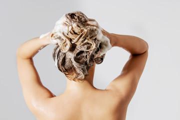 Woman washing her blond hair