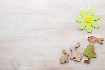 Spring and Easter decor. Wooden symbols bunny, flowers and butterflies.