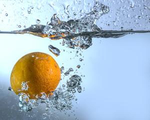 Orange in drops of water