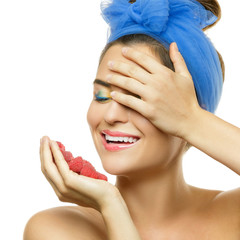Happy woman with raspberries
