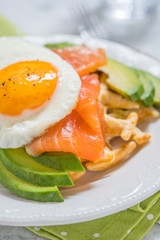 Healthy eating food breakfast oatmeal waffles, smoked salmon, avocado and egg