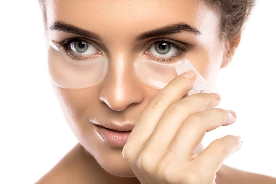 Woman with collagen pads under her eyes