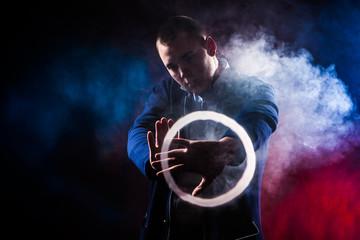 Man shows tricks with smoke. E-cigarettes.