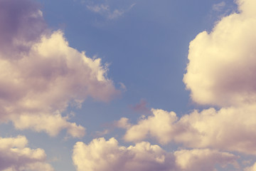 Abstract sky background with fluffy clouds In purple and pink tones , cloudscape