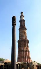 The Qutub Minar minaret and the iron pillar in New Delhi, India.
