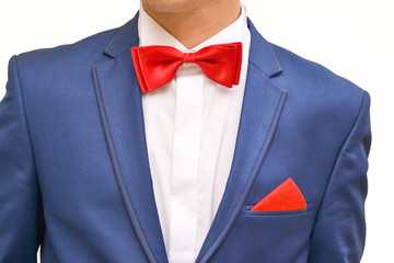 Man in blue suit with red handkerchief, close up