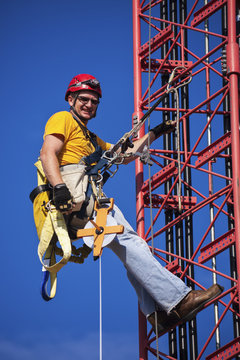 Climber ascending the cellular tower