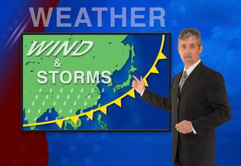 A tv television news weather man meteorologist anchorman is reporting with a Wind & Storm graphic over a map of Asia on the monitor screen.