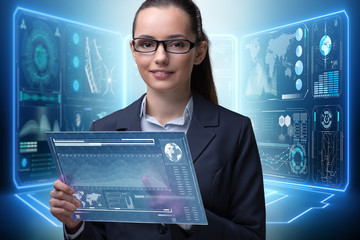 Businesswoman with tablet in data mining concept