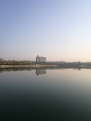 lake and high-rise building