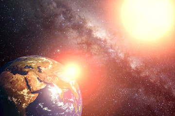 View of planet earth and sun.  Background of cosmos with milkyway and shining star. Elements of this image are furnished by NASA