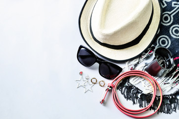 Top view of summer accessories for modern woman on white background