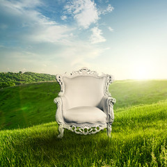 Wall Mural - Arm chair and landscape on sunset