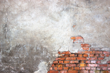 urban background of a brick wall with destroyed stucco