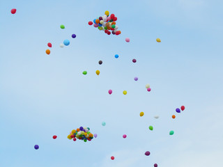Colorful balloons on a blue sky background.