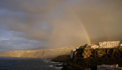 Double rainbow after heavy rain over residential area of the city Puerto de la Cruz, island Tenerife.
