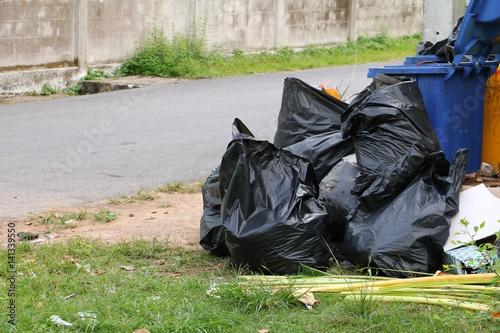 """Pile black garbage bag roadside in the city"" Stock photo ..."