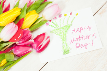 Bouquet of tulips  and kid's picture for mother