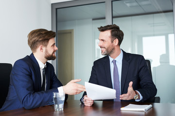 job interview - happy recruiter talking with candidate