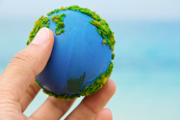concept image of Earth in hand