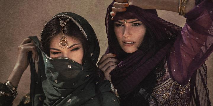 Arabian woman traveling in desert. Sandstorm effect not noise