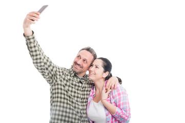 Happy smiling pair taking a selfie