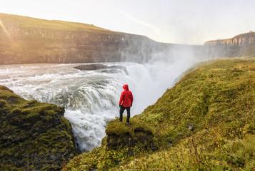 Hiker over waterfall