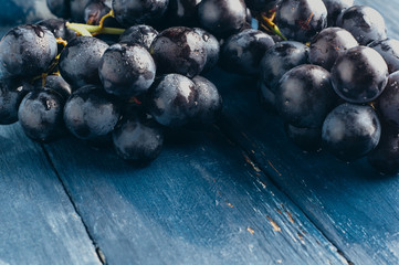Grapes on a dark wooden background