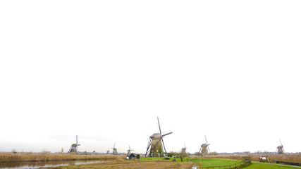 Windmills in landscape view with smooth river surface