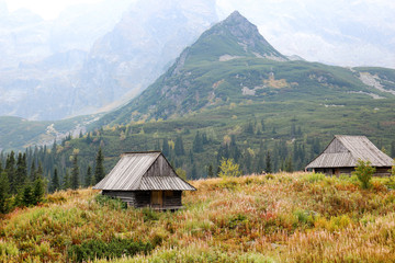 Two wooden cottage among the mountains