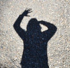 My shadow waving on shale background.
