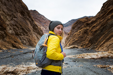 Trekker walking in Death Valley National Park, California, US