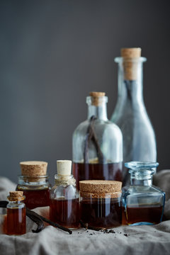 a group of bottles with home made vanilla extract