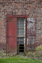 Rustic rectangular window on vintage brick wall.
