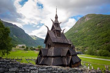 Garden Poster Scandinavia Borgund Stave Church and mountain background