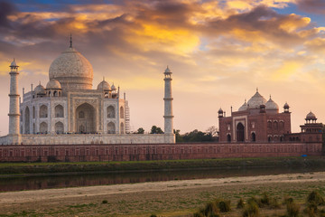 Wall Mural - Historic Taj Mahal at sunset as viewed from Mehtab Bagh. Taj Mahal a white marble mausoleum designated as the UNESCO World heritage site.