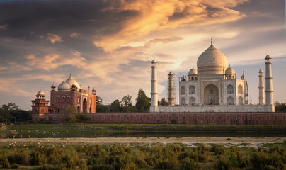 Wall Mural - Taj Mahal Agra at sunset as seen from Mehtab Bagh on the banks of the river Yamuna. Taj Mahal designated as a World Heritage Site is a masterpiece of Indian heritage and architecture.