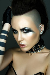 Woman portrait in rock style with grunge make up.
