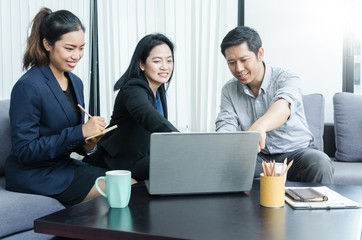 Group of asian peoples dicussing something while working in office.