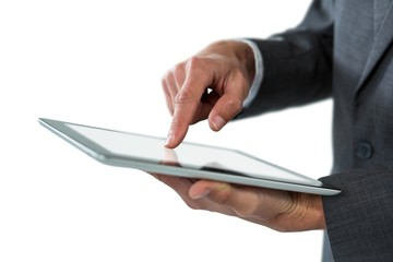 Mid section of businessman using digital tablet
