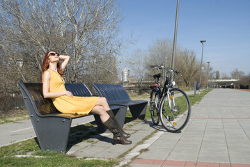 Attractive woman sitting on bench