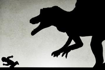 shadow of spinosaurus chasing human  on wall no logo or trademark